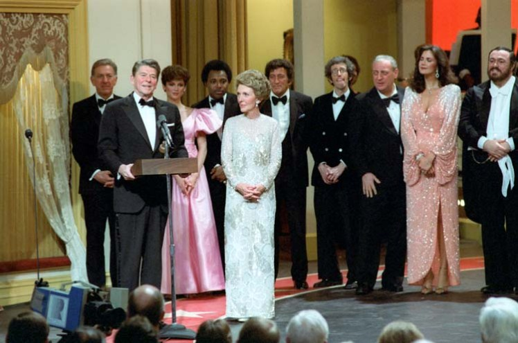 """3/21/1981 President Reagan addresses the crowd during Ford's Theatre Gala """"The Stars Salute the President"""" with Nancy Reagan Tony Bennett Linda Carter Rodney Dangerfield L Pavarotti Jack Klugman Victoria Principal and George Benson"""